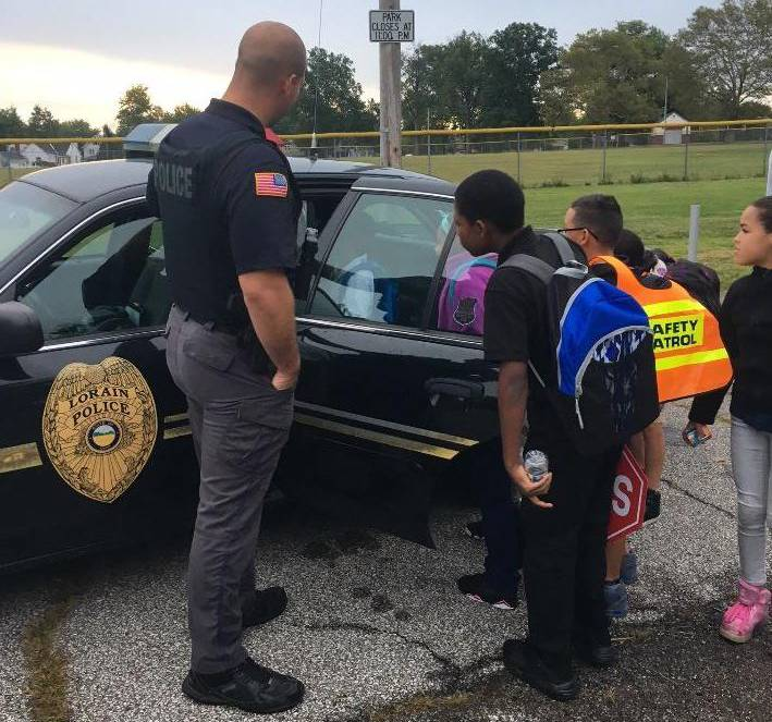 Students Looking at Police Cruiser